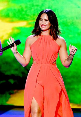 Singer-songwriter Demi Lovato speaks onstage at Nickelodeon's 2017 Kids' Choice Awards at USC Galen Center on March 11, 2017 in Los Angeles, California.  (Photo by Kevin Winter/Getty Images)