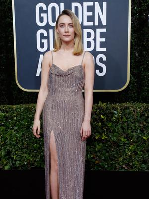 Feet on the ground: Saoirse Ronan at the 77th Golden Globe Awards in Beverly Hills.  Photo: Reuters