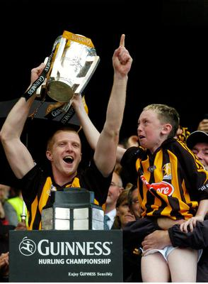 Kilkenny's Henry Shefflin lifts the Liam MacCarthy cup with Darragh McGarry, son of James McGarry, right. Guinness All-Ireland Senior Hurling Championship Final, Kilkenny v Limerick in 2007
