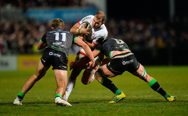 Will Addison of Ulster is tackled by Kyle Godwin and Robin Copeland of Connacht. Photo by Oliver McVeigh/Sportsfile
