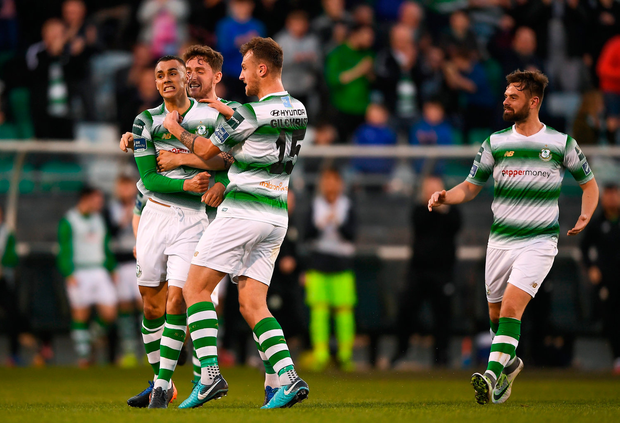 Graham Burke of Shamrock Rovers (left) celebrates with teammates after scoring his side's first goal. Photo: Harry Murphy/Sportsfile