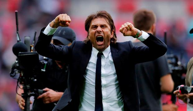 Chelsea manager Antonio Conte celebrates after the match