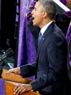 """U.S. President Barack Obama  leads mourners in singing the song """"Amazing Grace"""" as he deliversa eulogy in honor of the Rev. Clementa Pinckney during funeral services for Pinckney in Charleston, South Carolina June 26, 2015. Pinckney is one of nine victims of a mass shooting at the Emanuel African Methodist Episcopal Church.   REUTERS/Jonathan Ernst"""