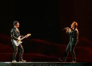 The Edge (L) performs with Bono during the opening concert of rock group U2's global The Joshua Tree Tour 2017 in Vancouver, British Columbia, Canada May 12, 2017. Picture taken May 12, 2017. REUTERS/Nick Didlick