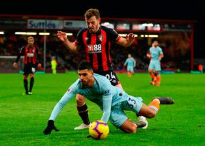 Ryan Fraser of AFC Bournemouth battles for possession with Emerson of Chelsea. Photo by Warren Little/Getty Images