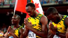 Jamaica's Men's 4x100m relay team of Usain Bolt (centre), Asafa Powell (not pictured), Nickel Ashmeade (right) and Nesta Carter pray ahead of the race during day eight of the IAAF World Championships at the Beijing National Stadium, China. PRESS ASSOCIATION Photo. Picture date: Saturday August 29, 2015. See PA story ATHLETICS World. Photo credit should read: Adam Davy/PA Wire. RESTRICTIONS: Editorial use only. No transmission of sound or moving images and no video simulation. Call 44 (0)1158 447447 for further information