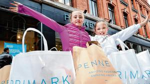 Normality: Brooke Sherry (8) and Ella O'Reilly (11), both from Dublin city centre, at the re opening of Penneys on Mary Street. Photo: Steve Humphreys