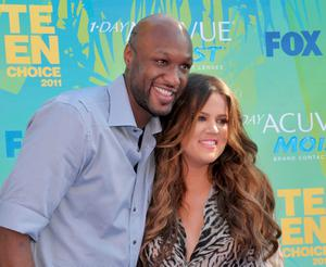 Khloe Kardashian and Lamar Odom arrive at Teen Choice 2011 at the Gibson Amphitheatre on August 7, 2011 in Universal City, California.  (Photo by Gregg DeGuire/FilmMagic)