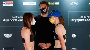 Katie Taylor and Delfine Persoon at yesterday's Essex weigh-in ahead of their undisputed lightweight title fight tonight. Photo: Matchroom Boxing via Sportsfile