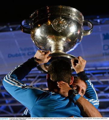 Dublin's Diarmuid Connolly, left, and Eoghan O'Gara with the Sam Maguire cup during the homecoming celebrations of the All-Ireland Senior Football Champions