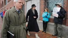 """Defense attorneys for accused Boston Marathon bomber Dzhokhar Tsarnaev, David Bruck (L) and Judy Clarke (C), arrive at the federal courthouse for opening statement's in Tsarnaev's trial in Boston, Massachusetts, March 4, 2015. The attorneys walked past Joe Kebartas holding a sign reading """"Death Penalty is Murder.""""     REUTERS/Brian Snyder    (UNITED STATES - Tags: CRIME LAW)"""
