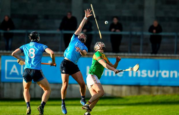 Dublin's Jake Malone battles for possession with Jack Murphy of Carlow. Photo: Sam Barnes/Sportsfile