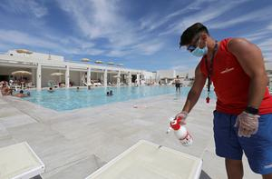 Summer season: The pool area of a holiday village in Sicily is cleaned for its first visitors since the lockdown. PHOTOS: REUTERS