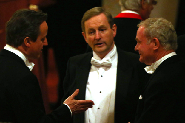 Taoiseach Enda Kenny (centre) and Martin McGuinness, the Deputy First Minister of Northern Ireland (right) talk to Prime Minister David Cameron as they attend a State Banquet in honour of President Michael D. Higgins at Windsor Castle