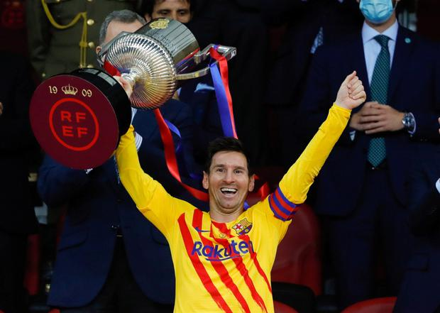 Lionel Messi celebrates winning the Copa del Rey with the trophy. RFEF/Handout via REUTERS