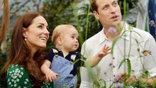 Catherine, Duchess of Cambridge holds Prince George as he and Prince William, Duke of Cambridge's look on while visiting the Sensational Butterflies exhibition at the Natural History Museum