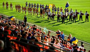 Crossmaglen and Maghery teams parade behind the band prior to the Armagh SFC at the Athletic Grounds on Sunday. Photo: Sportsfile