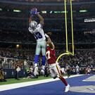 Dallas Cowboys wide receiver Michael Gallup (13) catches a touchdown pass over Washington Redskins cornerback Aaron Colvin at AT&T Stadium on Sunday night. The Cowboys won the game 47-16 but it wasn't enough to extend their season. Photo: Kevin Jairaj - USA Today Sports
