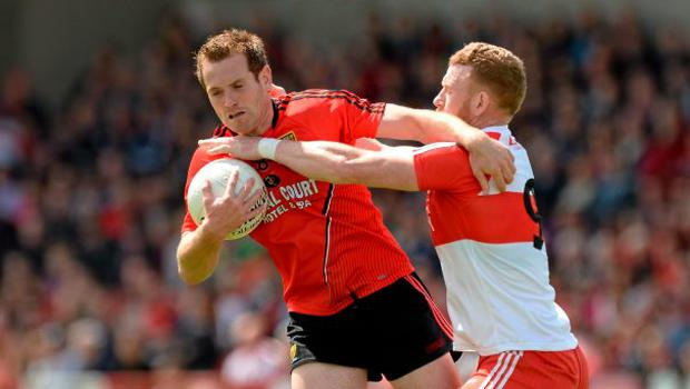 Peter Fitzpatrick, Down, in action against Fergal Doherty, Derry