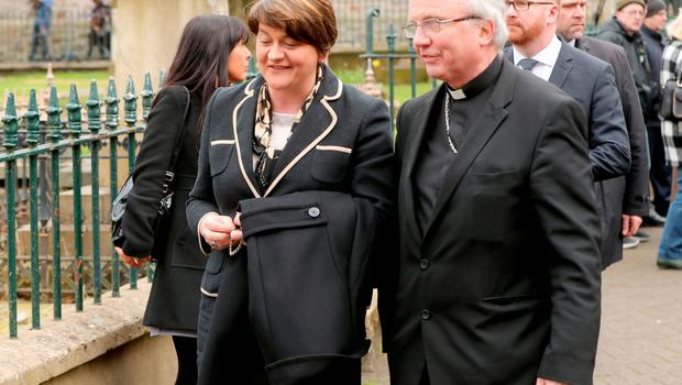 Arlene Foster and Bishop John McKeown arriving for the funeral of Northern Ireland's former deputy first minister and ex-IRA commander Martin McGuinness Photo: Niall Carson/PA Wire