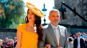 Amal Clooney and George Clooney arrive at St George's Chapel at Windsor Castle for the wedding of Meghan Markle and Prince Harry. PRESS ASSOCIATION Photo. Picture date: Saturday May 19, 2018. See PA story ROYAL Wedding. Photo credit should read: Gareth Fuller/PA Wire