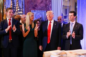 U.S. President-elect Donald Trump (C) smiles as he is applauded by his son Eric Trump (L) daughter Ivanka and son in law Jared Kushner (R) ahead of a press conference in Trump Tower, Manhattan, New York, U.S., January 11, 2017. REUTERS/Shannon Stapleton