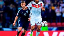 Emre Can of Germany is closed down by Shaun Maloney of Scotland during the UEFA EURO 2016 Qualifier Group D match between Scotland and Germany at Hampden Park