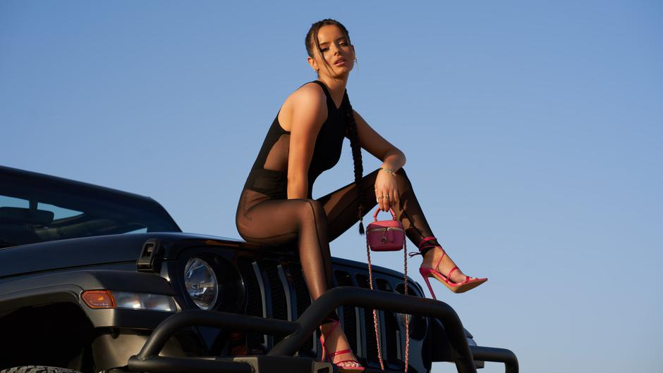 Maura models a selection of shoes from her Ego range in a Dubai desert