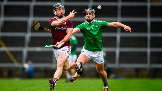Sleight of hand: Sean Linnane of Galway gets rid of the sliotar with Limerick's Darragh O'Donovan in pursuit. Photo by Diarmuid Greene/Sportsfile