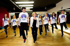 05/05/2015 NO REPRO FEE, MAXWELLS DUBLIN. Pic shows: Padraic Moyles (l) with Regina Prenderville; Project Manager; Pulmonary Hypertension Association - Ireland and dancers from the Riverdance Troupe. Dancers from the Riverdance Troupe mark World Pulmonary Hypertension Day at the 1Escape Gym in Smithfield. The dancers were working out preparing for their return to the Gaiety Theatre for their annual summer season while 'Getting Breathless for Pulmonary Hypertension' (PH).? World PH Day (5 May) is recognised across the globe and sees activities take place all over the world to highlight awareness of this devastating disease. PIC: NO FEE, MAXWELLS.