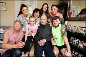 Happy family: Kyran O'Brien returns home to Finglas where he was met by wife Pat and their family from back left, granddaughter Megan, daughters Lisa and Debbie and (in front from left) son Kyran Jnr, grandaughter Rhea (5) and grandson Sean. Photo: Steve Humphreys