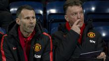 Manchester United's manager Louis van Gaal, right, takes his seat next to assistant manager Ryan Giggs before the English FA Cup Fifth Round soccer match between Preston and Manchester United at Deepdale Stadium in Preston, England, Monday Feb. 16, 2015.  (AP Photo/Jon Super)