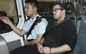 Rurik Jutting arrives at court in Eastern Court in Hong Kong (AP)