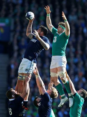 Scotlands Jim Hamilton and Irelands Jamie Heaslip compete in a line out. Reuters / Russell Cheyne