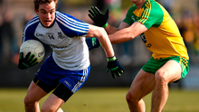 Monaghan's Jack McCarron in action against Neil McGee of Donegal. Photo: Philip Fitzpatrick/Sportsfile