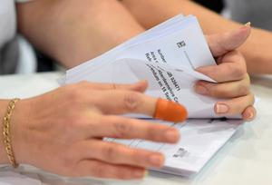 A woman counts ballots at a counting centre in Aberdeen, Scotland,  September 18, 2014.