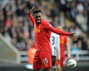 Daniel Sturridge celebrates scoring his side's third goal