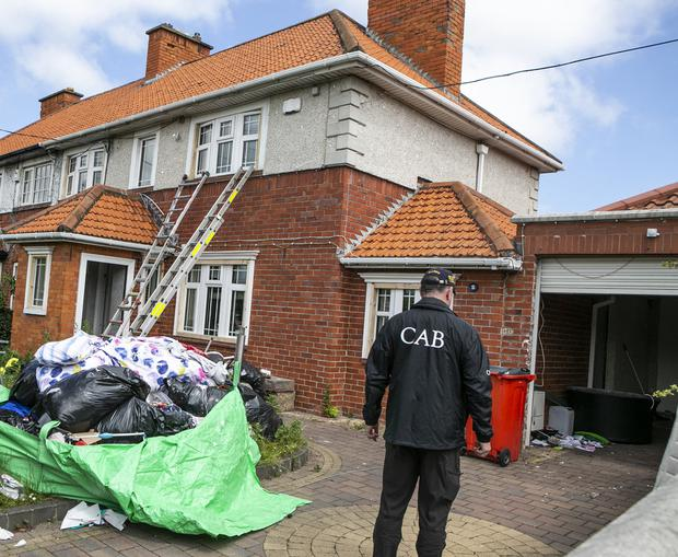 The Criminal Assets Bureau (CAB) taking possession of Liam Byrne's house in Crumlin in Dublin