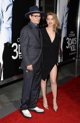"HOLLYWOOD, CA - FEBRUARY 12:  Actor Johnny Depp and actress Amber Heard arrive at the premiere of ""3 Days to Kill"" at ArcLight Cinemas on February 12, 2014 in Hollywood, California.  (Photo by Jason Merritt/Getty Images)"