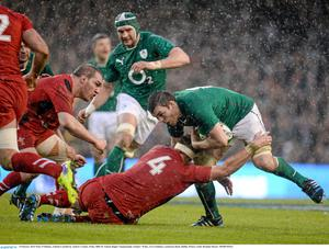 Peter O'Mahony, Ireland is tackled by Andrew Coombs