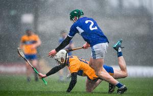 Clare's Ryan Taylor feels the pressure from Diarmuid Conway of Laois. Photo: Eóin Noonan/Sportsfile