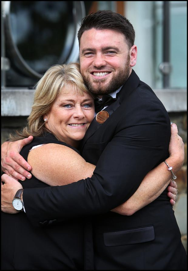 Business Consultant Thomas Lynch from Kerry is congratulated by his Mum Ellen after he was named Escort of the Year at the Rose of Tralee International Festival in Tralee Co Kerry. Pic Steve Humphreys