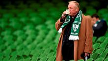 An Ireland supporter enjoys a pint ahead of a game Picture credit: Brendan Moran / SPORTSFILE