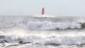 The Poolbeg lighthouse in Dublin is battered by heavy seas in the wake of Storm Imogen. Photo: Collins