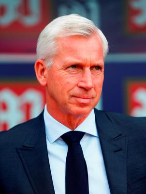 Alan Pardew, manager of Crystal Palace looks on