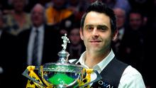 Ronnie O'Sullivan celebrates with his trophy. Photo: PA