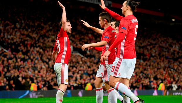 Juan Mata is congratulated by his teammates after scoring the winning goal of the tie. Photo: Ross Kinnaird/Getty Images