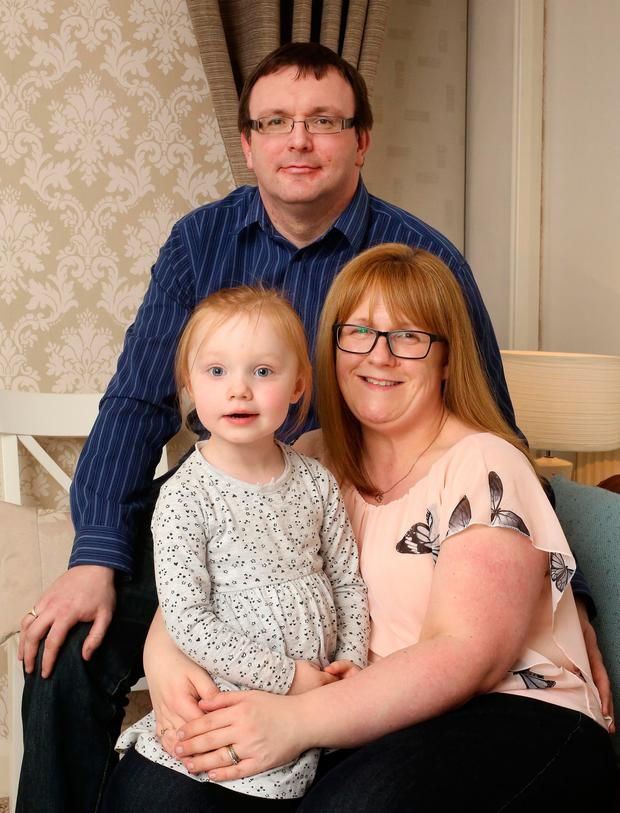 Nigel and Denise Black pictured with their daughter Chloe, aged 2, at their home in Swords. Photo: Frank Mc Grath