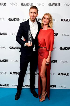 Calvin Harris with his Man Of The Year award, alongside presenter Rosie Huntingdon-Whiteley, at the Glamour Women of the Year Awards 2015 held at Berkeley Square Gardens, London