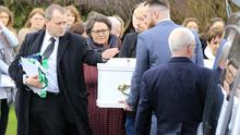 Andrew McGinley pictured outside the Church of the Holy family as his children arrive for their funeral mass.  Picture; Gerry Mooney